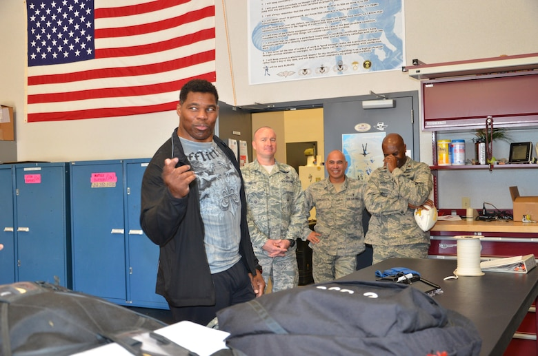 NFL football hero Herschel Walker visited Patrick Air Force Base, January 24, taking  time to meet with Guardian Angel Airmen from the 920th Rescue Wing. These elite warrior Airmen undergo intense physical and mental training to rescue isolated personnel in combat. They toured Walker through their squadron and demonstrated some of their rescue skills. Throughout the visit, Walker held their rapt attention sharing lots of inspirational accounts of his days playing football. Later that afternoon, Walker stood in front of several hundred Patrick AFB employees who came to listen to his personal battled with mental illness. (U.S. Air Force photo/Maj. Cathleen Snow)