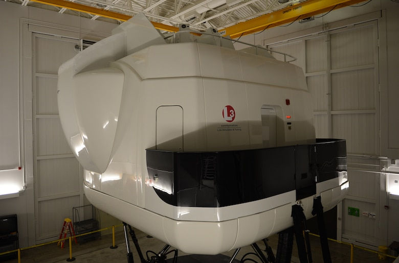 A C-17 Globemaster III flight simulator sits ready for pilots to board before a training Jan. 26, 2017 at Joint Base Lewis-McChord, Wash. McChord C-17 pilots maintain current and ready for any mission at a moment's notice by conducting regular training throughout the year in the simulator. (U.S. Air Force photo/Senior Airman Divine Cox)