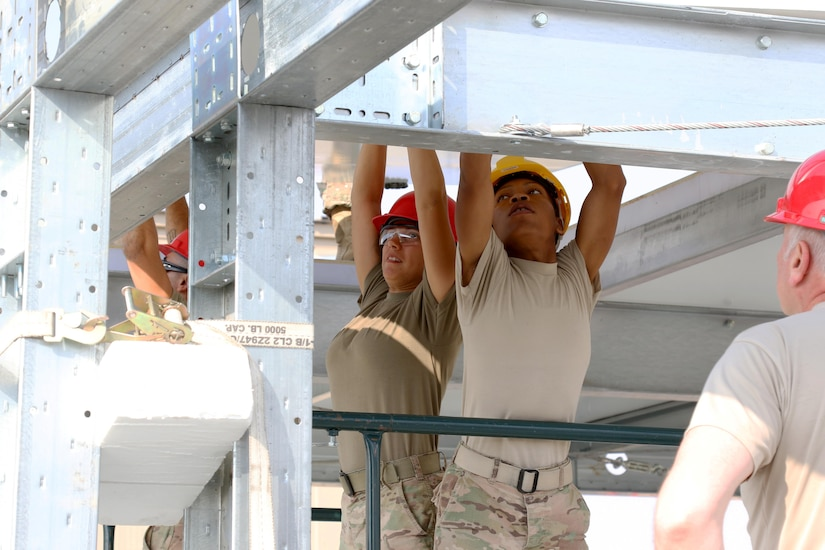 Soldiers from the 176th Engineer Brigade of the Texas Army National Guard, also known as Task Force Chaos, build the steel frame of a two-story modular unit Jan. 11, 2017, which will have the capacity to hold 160 individuals with 20 climate controlled rooms on each floor at Camp Redleg in Southwest Asia. This is a U.S. Army Central Command directed project to enhance the quality of life and save millions of dollars in the future with energy cost savings and troop labor.