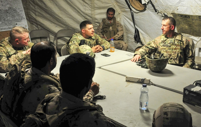 Lt. Col. Michael Zopfi, commander of the 2nd Squadron, 13th Cavalry Regiment, briefs Maj. Gen. William B. Hickman, the U.S. Army Central deputy commanding general of operations, about ongoing training during a joint military exercise at Udairi Range, Kuwait Sept. 26, 2016. (U.S. Army Photo by Sgt. Aaron Ellerman)
