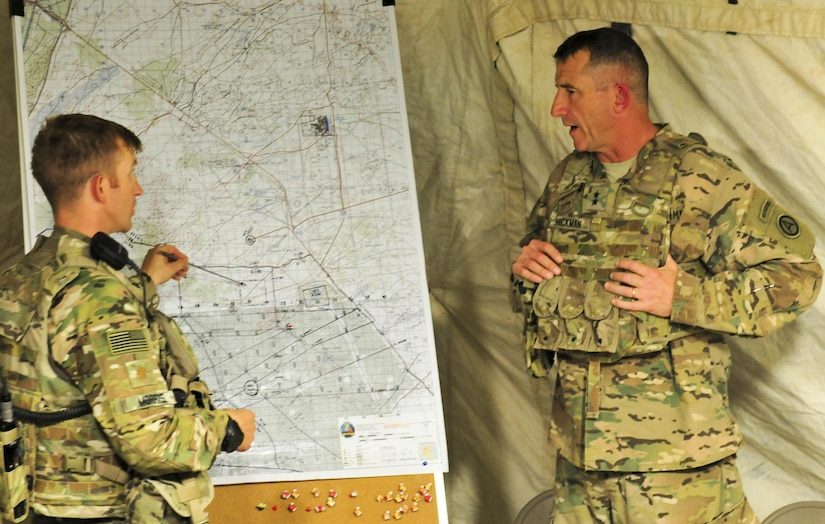 Maj. George Morris, 2nd Squadron, 13th Cavalry Regiment operations and training officer, shows Maj. Gen. William B. Hickman, U.S. Army Central deputy commanding general – operations, training objectives and points of engagement planned during a multinational training exercise occurring at, Udairi range, Kuwait Sept. 26, 2016. (U.S. Army Photos by Sgt. Aaron Ellerman)