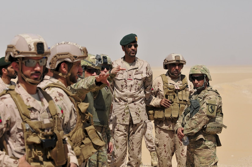 Maj. George Morris, 2nd Squadron 13th Cavalry Regiment operations and training officer, explains operations to Maj. Gen. Saleh M. Al Ameri, the commander of the UAE land forces, during an exercise at Udairi range, Kuwait, Sept. 28. U.S. and United Arab Emirate forces trained together during a multi-day exercise designed to test armored vehicle maneuver and reaction capabilities. (U.S. Army Photos by Sgt. Aaron Ellerman)