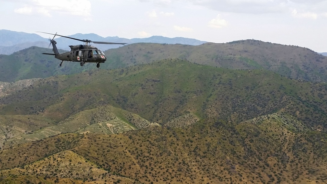 KHOST PROVINCE, Afghanistan - Pilots and crew of a UH-60 Blackhawk helicopter flying a routine training mission over Khost Province, Afghanistan.  The team are members of  Task Force Gunfighters, Charlie Company, 2nd General Support Aviation Battalion, 1st Aviation Regiment,, 1st Infantry Division Combat Aviation Brigade who are deployed providing air medical evacuation support to Chapman Theater Hospital.   (Photo courtesy U.S. Army Capt. Cody Sneed, 2-1 GSAB)