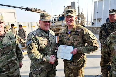 BAGRAM AIRFIELD, Afghanistan (Dec. 18, 2016) - Gen. Mark A. Milley presents the Air Medal to Capt. Cody Sneed during a ceremony held near the U.S. Forces Afghanistan headquarters here. Milley is the Chief of Staff of the U.S. Army, Sneed is a UH-60 Blackhawk MEDEVAC helicopter pilot who helped save the life of an Afghan National Army Soldier critically wounded during a Sept. 21 combat operation in Khost Province.  Also photographed is Sergeant Major of the Army Daniel A. Dailey.  (Photo by Bob Harrison, U.S. Forces Afghanistan Public Affairs)