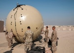 Signal Soldiers of the 369th Sustainment Brigade practice aligning a Ground Antenna Transmit Receive (GATR) Ball at Camp Arifjan, Kuwait on Jan. 10, 2017. The GATR Ball is a portable satellite communications system that can be deployed to remote areas in a relatively short amount of time. (U.S. Army photo by Sgt. Jeremy Bratt)