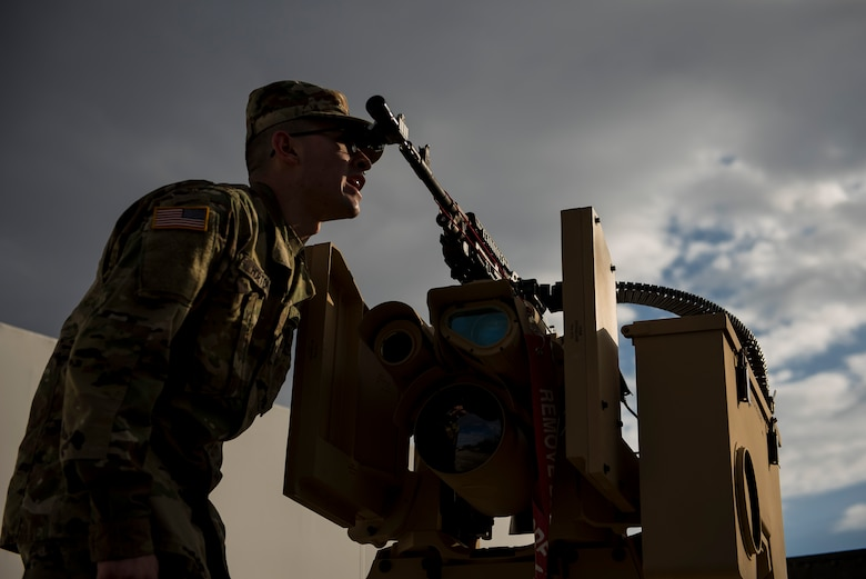 Pfc Seth Horton, U.S. Army Reserve military police Soldier with the 346th Military Police Company, of Wichita, Kansas, performs a boresight alignment on a crew serve weapon mounted to a Common Remotely Operated Weapon Station (CROWS), at Fort Chaffee, Arkansas, Jan. 25. The CROWS is a remote-controlled system compatible with four major crew-serve weapons, and it was developed to keep gunners safe within the vehicle while engaging enemy targets. (U.S. Army Reserve photo by Master Sgt. Michel Sauret)