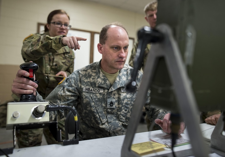 Sgt. 1st Class Monty Hearod, U.S. Army Reserve Soldier with the 370th Chemical Company, Fort Worth, Texas, trains on a Common Remotely Operated Weapon Station (CROWS), at Fort Chaffee, Arkansas, Jan. 26. The CROWS is a remote-controlled system compatible with four major crew-serve weapons, and it was developed to keep gunners safe within the vehicle while engaging enemy targets. (U.S. Army Reserve photo by Master Sgt. Michel Sauret)