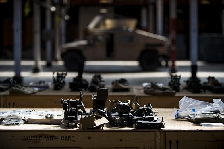 A row of basic issue items used to mount weapons to the Common Remotely Operated Weapon Station (CROWS) is laid out on crates during the installation process at Fort Chaffee, Arkansas, Jan. 26. The CROWS is a remote-controlled system compatible with four major crew-serve weapons, and it was developed to keep gunners safe within the vehicle while engaging enemy targets. (U.S. Army Reserve photo by Master Sgt. Michel Sauret)