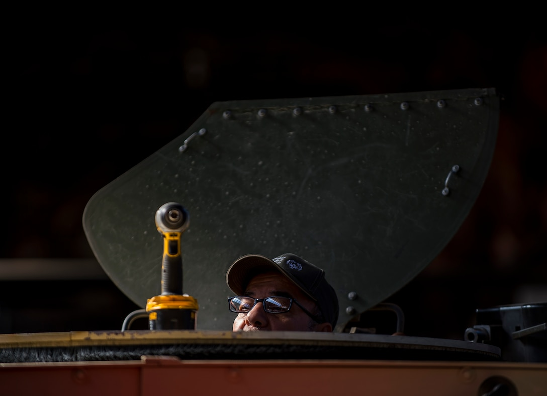 Pablo Flores, an installer and instructor for the Materiel Fielding & Training Team, prepares a turret to install a Common Remotely Operated Weapon Station (CROWS), at Fort Chaffee, Arkansas, Jan. 26. The CROWS is a remote-controlled system compatible with four major crew-serve weapons, and it was developed to keep gunners safe within the vehicle while engaging enemy targets. (U.S. Army Reserve photo by Master Sgt. Michel Sauret)