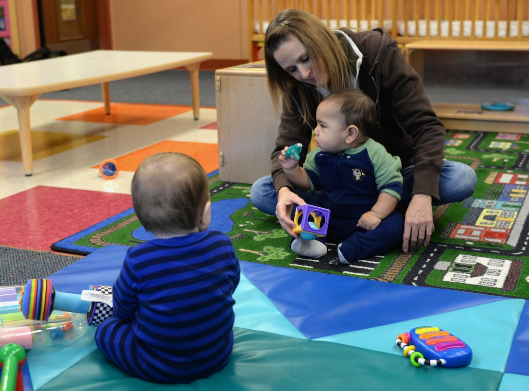 Michelle Caslin, the Child Development Center program lead, interacts with children Jan. 26, 2017, at the CDC on Little Rock Air Force Base, Ark. The CDC's goal is to support each child's needs and abilities and challenge them to reach their individual potential. (U.S. Air Force photo by Airman 1st Class Codie Collins)