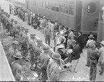 Persons of Japanese ancestry arrive at Santa Anita Assembly center from San Pedro, California, April 5, 1942, Arcadia, California.