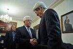 Palestinian Authority President Mahmud Abbas greets U.S. Secretary of State John Kerry as he arrives for meeting in Amman, Jordan, June 2013.