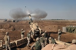 Marines from Mike Battery, 4th Battalion, 14th Marines, operate 155mm M198 howitzer in support of Operation Phantom Fury, November 2004.