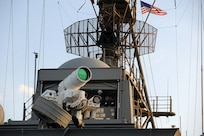 Afloat Forward Staging Base (Interim) USS Ponce conducts operational demonstration of Office of Naval Research–sponsored Laser Weapon System while deployed to Arabian Gulf, November 15, 2014.