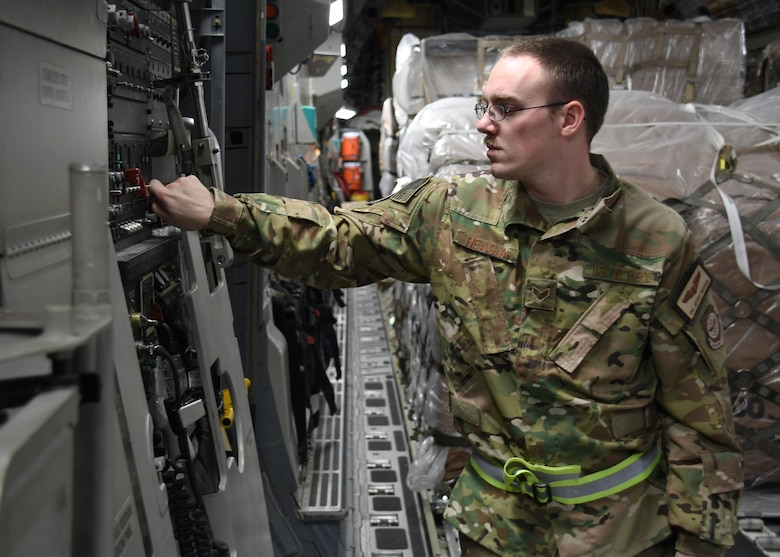 U.S. Air Force Senior Airman Jefery Reagan, a loadmaster with the 816th Expeditionary Airlift Squadron, lowers the ramp on a C-17 Globemaster III at Al Udeid Air Base, Qatar, Dec. 23, 2016. As a loadmaster, Reagan distributes and straps down cargo on C-17 aircraft so it will be safe and secure while in flight. Although there are multiple mobility forces assigned to Air Forces Central, the 816th EAS is one of the closest 18th Air Force assigned units supporting the fight in Iraq and Syria.  (U.S. Air Force photo by Senior Airman Miles Wilson)