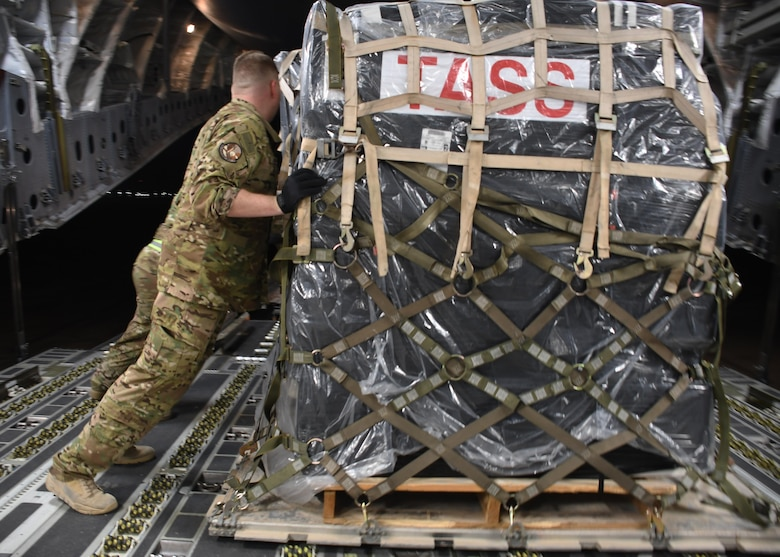 U.S. Air Force Staff Sgt. Cameron Morris, a loadmaster with the 816th Expeditionary Airlift Squadron, pushes a pallet into place on a C-17 Globemaster III at Al Udeid Air Base, Qatar, Dec. 23, 2016. Loadmasters ensure that the weight on an aircraft is distributed evenly, otherwise it could cause issues while in flight that may endanger the personnel. (U.S. Air Force photo by Senior Airman Miles Wilson)