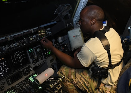 U.S. Air Force 1st Lt. Wesley Cobb, a pilot with the 816th Expeditionary Airlift Squadron, performs preflight checks on a C-17 Globemaster III at Al Udeid Air Base, Qatar, Dec. 23, 2016. The C-17 is capable of rapid strategic delivery of troops and of cargo to main operating bases or directly to forward operating bases in the U.S. Central Command area of responsibility. (U.S. Air Force photo by Senior Airman Miles Wilson)
