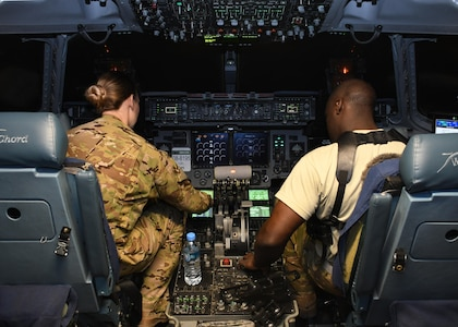 U.S. Air Force Capt. Brittany Bean, left, and U.S. Air Force 1st Lt. Wesley Cobb, right, C-17 Globemaster III pilots with the 816th Expeditionary Airlift Squadron, perform preflight checks at Al Udeid Air Base, Qatar, Dec. 23, 2016. The 816th EAS is one of the closest 18th Air Force assigned units supporting the fight in Iraq and Syria. As the only expeditionary squadron directly reporting to 18th AF, it draws on aircrews and maintainers from every C-17 unit to provide theater-direct delivery to the U.S. Central Command area of responsibility.  (U.S. Air Force photo by Senior Airman Miles Wilson)