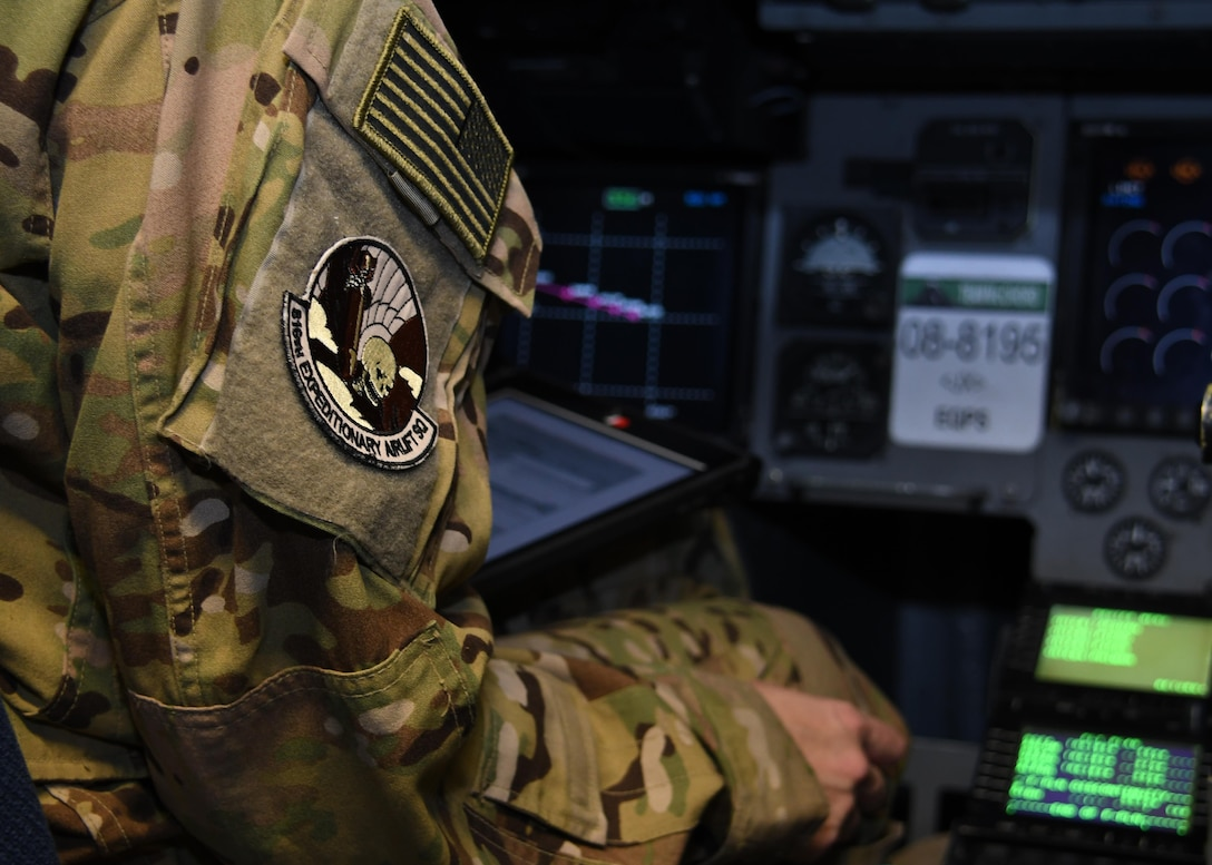 U.S. Air Force Capt. Brittany Bean, a pilot with the 816th Expeditionary Airlift Squadron, goes through preflight checks before taking off at Al Udeid Air Base, Qatar, Dec. 23, 2016. Bean pilots C-17 Globemaster III aircraft, which have the ability to rapidly project and sustain an effective combat force close to a potential combat area. In 2016, the squadron flew more than 2,400 missions, moving nearly 102,000 tons of cargo and almost 120,000 passengers. (U.S. Air Force photo by Senior Airman Miles Wilson)