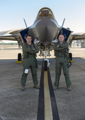 "Florida Air National Guard pilots Lt. Col. Scott ""Gaucho"" Charlton, left, and Maj. John ""Rocky"" MacRae stand in front of the F-35A Lightning II at Eglin Air Force Base on Jan. 24, 2017. Gaucho and Rocky are both F-35 instructor pilots with the 58th Fighter Squadron based at Eglin and are responsible for teaching pilots how to fly the Department of Defense's newest aircraft."