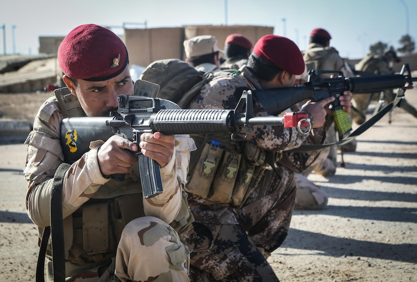 Iraqi soldiers from 7th Iraqi Army Division provide security during the platoon assault movement portion of their culminating training at Al Asad Air Base, Iraq, Jan. 15, 2017. Training at building partner capacity sites is an integral part of Combined Joint Task Force – Operation Inherent Resolve's effort to train Iraqi security forces personnel. CJTF-OIR is the global Coalition to defeat ISIL in Iraq and Syria. (U.S. Army photo by Sgt. Lisa Soy)