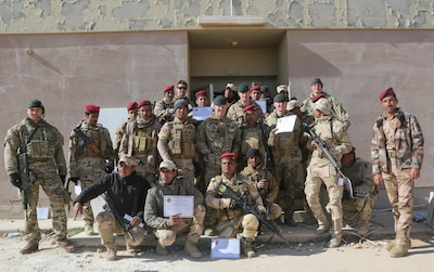 "Iraqi soldiers from 7th Iraqi Army Division, British trainers from 4th Battalion, ""The Rifles"", and Danish trainers show off graduation certificates after the culminating exercise at Al Asad Air Base, Iraq, Jan. 15, 2017. Training at building partner capacity sites is an integral part of Combined Joint Task Force – Operation Inherent Resolve's effort to train Iraqi security forces personnel. CJTF-OIR is the global Coalition to defeat ISIL in Iraq and Syria. (U.S. Army photo by Sgt. Lisa Soy)"
