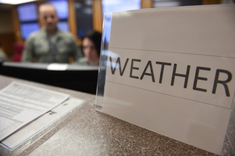 Red Flag 17-1 weather forecasters conduct a shift change at Nellis Air Force Base, Nev., Jan. 24, 2017. The forecast team works two separate shifts during the U.S. Air Force's premiere air-to-air combat training exercise ensuring accurate and timely weather inputs are incorporated into day and night mission planning. (U.S. Air Force photo by Staff Sgt. Natasha Stannard)
