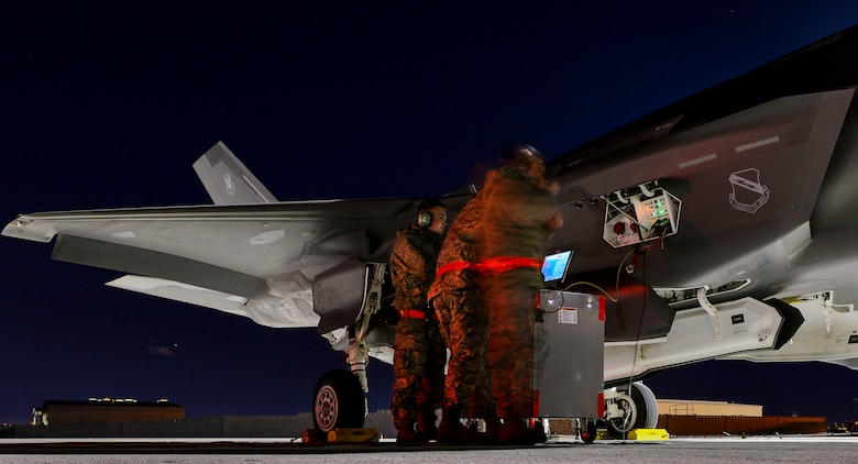 Maintainers from the 419th and 388th Fighter Wings conduct conducts preflight checks on an F-35A Lightning II from Hill Air Force Base, Utah, during Red Flag 17-1 at Nellis Air Force Base, Nev., Jan. 24, 2017. The F-35A will