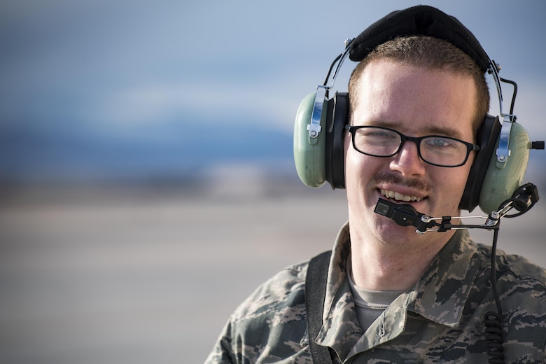 Staff Sgt. David Vance, 74th Aircraft Maintenance Unit weapons load-team chief, smiles while waiting to respond to an A-10C Thunderbolt II with a 'stuck gun' during Green Flag-West 17-03, Jan. 23, 2017, at Nellis Air Force Base, Nev. Weapons Airmen enabled joint force training during the two-week exercise by loading weapons, inspecting jets and maintaining munitions systems. Some of the live munitions included the Mark 82 and 84 general purpose bombs, high-explosive incendiary 30mm rounds and the 500 pound GBU-12 Paveway II laser-guided bomb. (U.S. Air Force photo by Staff Sgt. Ryan Callaghan)