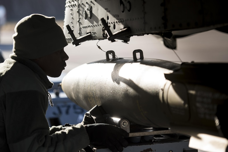 Staff Sgt. Tayrell Washington, 74th Aircraft Maintenance Unit weapons load team chief, guides a Mark 82 general purpose bomb into position underneath an A-10C Thunderbolt II during Green Flag-West 17-03, Jan. 24, 2017, at Nellis Air Force Base, Nev. Weapons Airmen enabled joint force training during the two-week exercise by loading weapons, inspecting jets and maintaining munitions systems. Some of the live munitions included the Mark 82 and 84 general purpose bombs, high-explosive incendiary 30mm rounds and the 500 pound GBU-12 Paveway II laser-guided bomb. (U.S. Air Force photo by Staff Sgt. Ryan Callaghan)