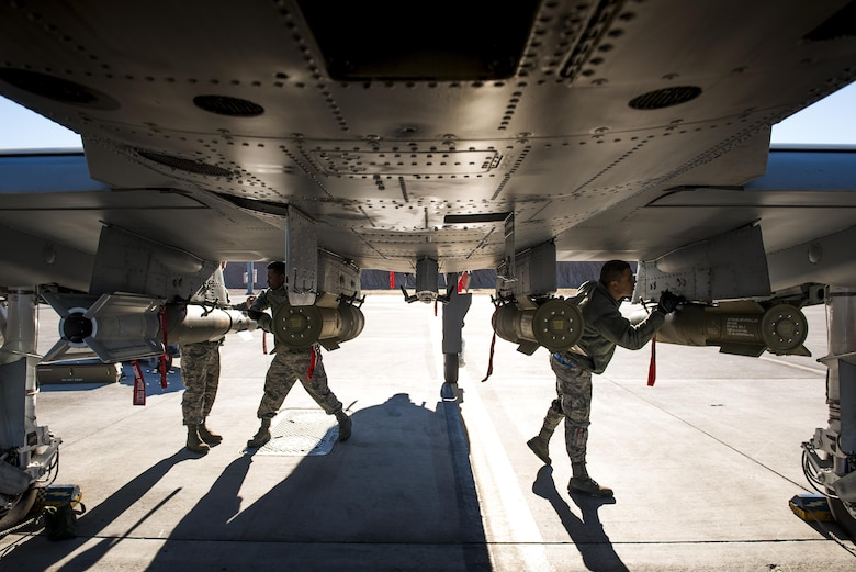 A weapons load team conducts final checks on munitions underneath an A-10C Thunderbolt II during Green Flag-West 17-03, Jan. 24, 2017, at Nellis Air Force Base, Nev. Weapons Airmen enabled joint force training during the two-week exercise by loading weapons, inspecting jets and maintaining munitions systems. Some of the live munitions included the Mark 82 and 84 general purpose bombs, high-explosive incendiary 30mm rounds and the 500 pound GBU-12 Paveway II laser-guided bomb. (U.S. Air Force photo by Staff Sgt. Ryan Callaghan)