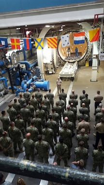 NEDU personnel stand in formation to listen to Vice Admiral Moore speak.