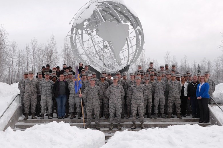 U.S. Air Force Airmen and civilians assigned to the 354th Communications Squadron (CS) pose for a group photo in the snow Jan. 26, 2017, at Eielson Air Force Base, Alaska. The 354th CS won the Air Force Lieutenant General Harold W. Grant Award for small communications unit. (U.S. Air Force photo by Airman 1st Class Cassandra Whitman)