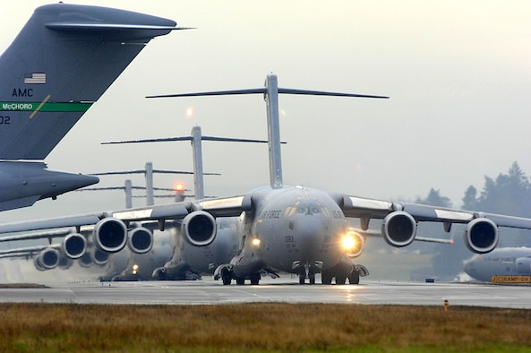 A line of C-17 Globemaster IIIs on Joint Base Lewis-McChord, Wash.