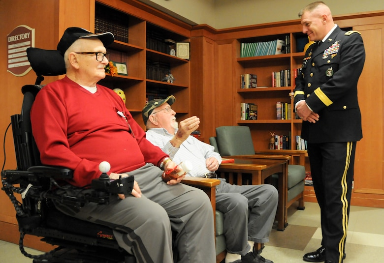 Maj. Gen. Troy D. Kok, commanding general of the U.S. Army Reserve's 99th Regional Support Command headquartered at Joint Base McGuire-Dix-Lakehurst, New Jersey, meets with (from left) George A. Teale, an Army private who served in World War II, and Larry H. Stange, a Marine sergeant who served in Korea, during a Jan. 28 visit to the New Jersey Department of Military and Veterans Affairs' Veterans Memorial Home in Vineland, New Jersey. The purpose of Kok's visit was to thank veterans for their service and encourage young Soldiers to spend time with veterans in their local area.