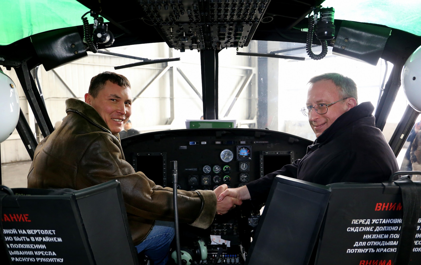 ALMATY, Kazakhstan (Jan. 27,2017) U.S.Ambassador to Kazakhstan, George Krol, right, shakes hands with Kazakh Air Force Major Sergey Kokonov insde of a Huey II Helicopter that was handed over to the Ministry of Defense of Kazakhstan. This is the fourth Huey helicopter provided to Kazakhstan through the U.S. Foreign Military Sales Program. (Courtesy photo)