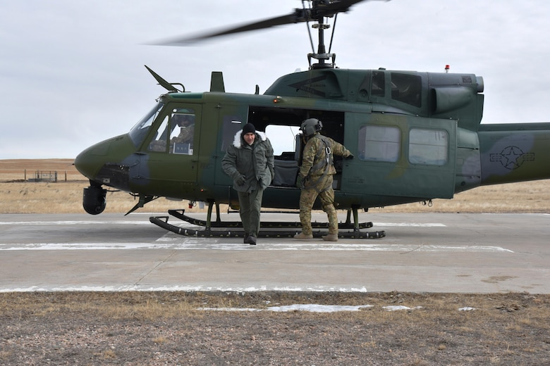 "U.S. Navy Vice Adm. Charles ""Chas"" A. Richard, U.S. Strategic Command deputy commander, exits a UH-1N Huey at a missile alert facility in the 90th Missile Wing missile complex, Jan. 26, 2017. Richard toured a MAF, which gave him insight to the responsibilities of the Airmen supporting the nation's nuclear deterrence mission. (U.S. Air Force photo by Airman 1st Class Breanna Carter)"