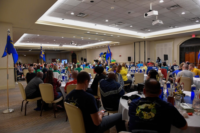 Members of Team Charleston listen to Cal McCombs, the guest speaker, at the 628th Air Base Wing Annual Awards ceremony at the Charleston Club, Jan. 27, 2017. Gold-medal Airmen and Sailors were recognized during the Olympic-themed event for their hard work throughout 2016.