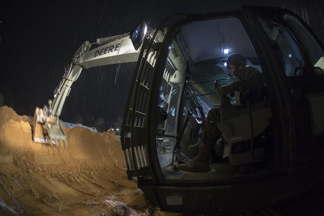 U.S. Marine Corps Pfc. Coe Vandivier, a heavy equipment operator with Marine Wing Support Squadron (MWSS) 171, operates a hydraulic excavator during exercise Kamoshika Wrath 17-1 at Haramura Maneuver Area, Hiroshima, Japan, Jan. 26, 2017. The Marines worked through inclement weather conditions and a short timeline to build a 96-foot by 96-foot vertical takeoff and landing pad. The exercise is a biannual, unit-level training exercise that is primarily focused on establishing a forward operating base and providing airfield operation services. MWSS-171 trains throughout the year completing exercises like Kamoshika Wrath to enhance their technical skills, field experience and military occupational specialty capability. (U.S. Marine Corps photo by Cpl. Donato Maffin)