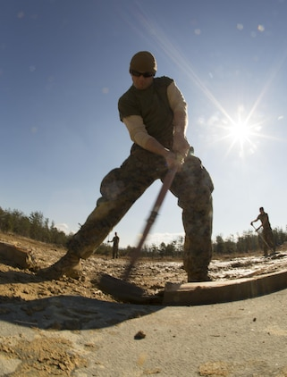 U.S. Marine Corps Cpl. Joseph Butler, an expeditionary airfield technician with Marine Wing Support Squadron (MWSS) 171, assembles a section of aluminum matting during exercise Kamoshika Wrath 17-1 at Haramura Maneuver Area, Hiroshima, Japan, Jan. 26, 2017. The Marines worked through inclement weather conditions and a short timeline to build a 96-foot by 96-foot vertical takeoff and landing pad. The exercise is a biannual, unit-level training exercise that is primarily focused on establishing a forward operating base and providing airfield operation services. MWSS-171 trains throughout the year completing exercises like Kamoshika Wrath to enhance their technical skills, field experience and military occupational specialty capability.   (U.S. Marine Corps photo by Cpl. Donato Maffin)