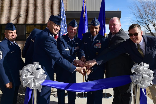 From left to right, Chief Master Sgt. Randy Lightsey, Dental Corps functional manager at Joint-Base San Antonio, Texas, Col. David Miller Jr., 460th Space Wing commander, Col. Matthew Hanson, 460th Medical Group commander, Maj. Gen. Roosevelt Allen, Medical Operations and Research Director and Chief of the Dental Corps Office of the Surgeon General in Washington D.C., Mark Spradling, Doyon Construction Group program manager, Neal Parker, engineer at U.S. Army Corps of Engineers, cut the ribbon at the grand opening of the dental clinic Jan. 30, 2017, on Buckley Air Force Base, Colo. The clinic will consist of 21 active-duty employees and will treat over 3,500 active-duty military members. (U.S. Air Force photo by Airman Jacob Deatherage/Released)