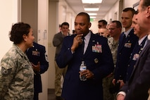 Maj. Gen. Roosevelt Allen, Medical Operations and Research Director and Chief of the Dental Corps Office of the Surgeon General in Washington D.C., listens to Tech. Sgt. Jacqueline Woodard, 460th Medical Group dental technician, on Buckley Air Force Base, Colo. Prior to the opening of the dental clinic, Buckley beneficiaries were required to receive treatment at off-base facilities. (U.S. Air Force photo by Airman Jacob Deatherage/Released)