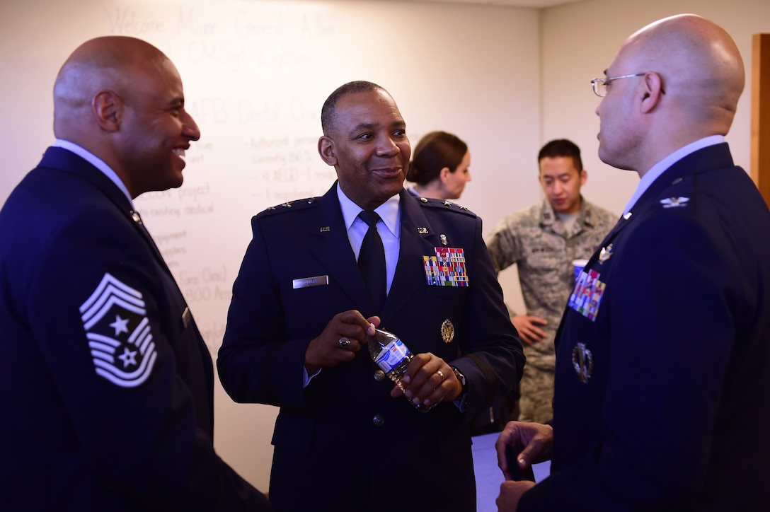From left to right, Chief Master Sgt. Rodney Lindsey, 460th Space Wing command chief, Maj. Gen. Roosevelt Allen, Medical Operations and Research Director and Chief of the Dental Corps Office of the Surgeon General in Washington D.C., and Col. David Miller Jr., 460th SW commander, discuss the opening of the new dental clinic Jan. 30, 2017, on Buckley Air Force Base, Colo. The new dental clinic will consist of 21 active-duty employees and will treat over 3,500 active-duty military members. (U.S. Air Force photo by Airman Jacob Deatherage/Released)