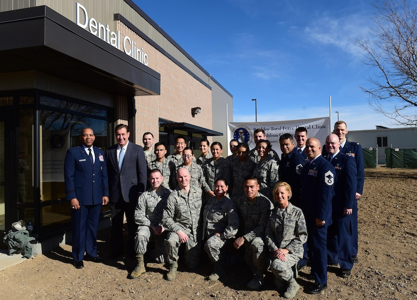 Maj. Gen. Roosevelt Allen, Medical Operations and Research Director and Chief of the Dental Corps Office of the Surgeon General in Washington D.C., and members from the 460th Space Wing stand in front of the new dental clinic Jan. 30, 2017, on Buckley Air Force Base, Colo. This is the first time since World War II that Buckley has had a dental clinic on base. (U.S. Air Force photo by Airman Jacob Deatherage/Released)