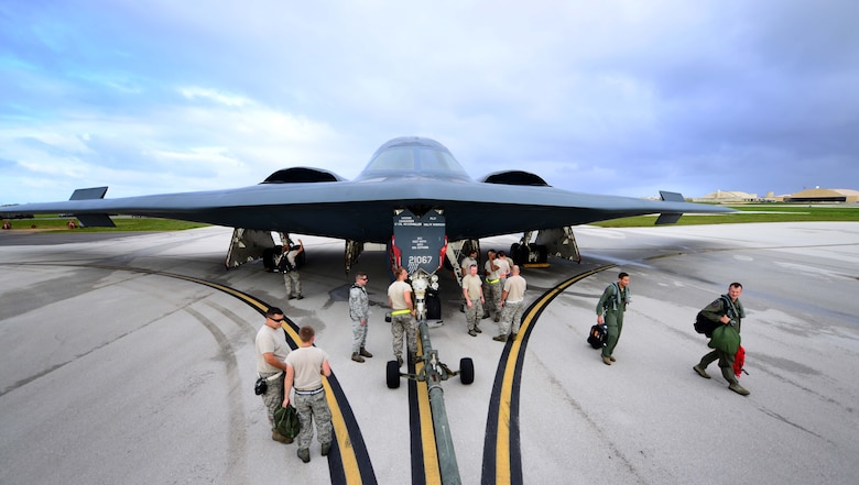 U.S. Air Force maintenance technicians assigned to the 509th Aircraft Maintenance Squadron, Whiteman Air Force Base, Mo., prepare a U.S. Air Force B-2 Spirit aircraft to be towed after a local training mission at Anderson Air Force Base, Guam Jan. 19, 2017. Close to 200 Airmen from Whiteman Air Force Base, Mo., and Barksdale Air Force Base, La., deployed to Andersen AFB, in support of U.S. Strategic Command Bomber and Deterrence missions. USSTRATCOM bomber missions familiarize aircrew with airbases and operations in different Geographic Combatant Commands. (U.S. Air Force photo by Tech Sgt. Andy M. Kin)