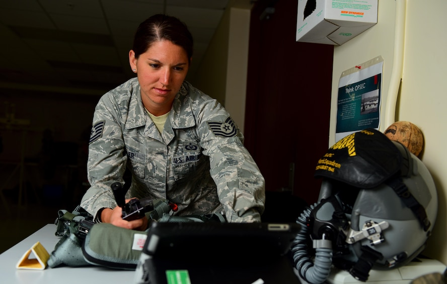U.S. Air Force Tech. Sgt. Suzanne Koehler, an aircrew flight equipment technician assigned to the 131st Operations Support Flight, reviews a technical order while performing a 30- day inspection on a harness at Andersen Air Force Base, Guam, Jan. 24, 2017. Close to 200 Airmen and three B-2s deployed from Whiteman Air Force Base, Mo., and Barksdale Air Force Base, La., to conduct local sorties and regional training and integrate with regional allies in support of Bomber Assurance and Deterrence missions. (U.S. Air Force photo by Airman 1st Class Jazmin Smith)