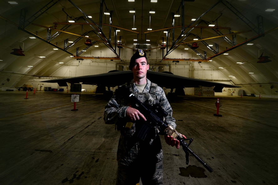 U.S. Air Force Senior Airman Andrew Conlon, a security forces member assigned to the 2nd Security Forces Squadron from Barksdale Air Force Base, La., stands guards at an entry control point Jan. 24, 2017 at Andersen Air Force Base, Guam. Close to 200 Airmen from Whiteman Air Force Base, Mo., and Barksdale Air Force Base, La., deployed to Andersen AFB, in support of U.S. Strategic Command Bomber and Deterrence missions. USSTRATCOM bomber missions familiarize aircrew with airbases and operations in different Geographic Combatant Commands. USSTRATCOM forces are on watch 24 hours a day, seven days a week to deter and detect strategic attack against the United States and our allies. (U.S. Air Force photo by Tech Sgt. Andy M. Kin)