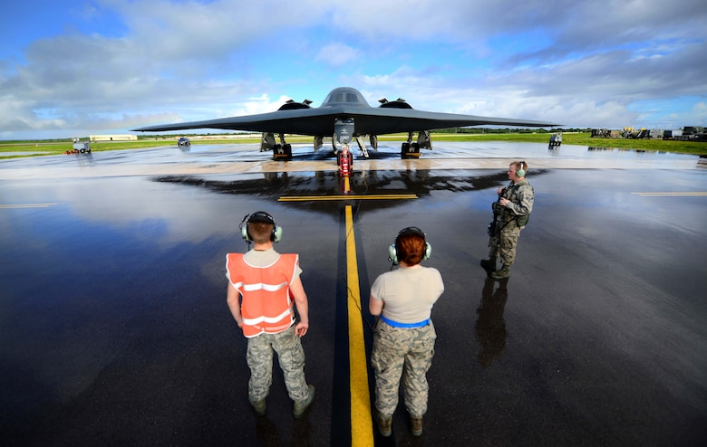 U.S. Air Force maintenance technicians assigned to the 509th Aircraft Maintenance Squadron, Whiteman Air Force Base, Mo., communicate with a B-2 Spirit pilot during pre-flight checks prior to a local training mission at Anderson Air Force Base, Guam Jan. 12, 2017. Close to 200 Airmen from Whiteman Air Force Base, Mo., and Barksdale Air Force Base, La., deployed to Andersen AFB, in support of U.S. Strategic Command Bomber and Deterrence missions. USSTRATCOM bomber missions familiarize aircrew with airbases and operations in different Geographic Combatant Commands. (U.S. Air Force photo by Tech Sgt. Andy M. Kin)
