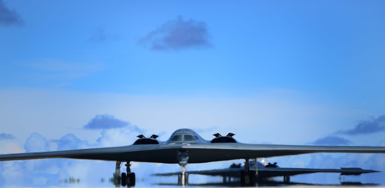 Two U.S. Air Force B-2 Spirit aircraft deployed from Whiteman Air Force Base, Mo., taxi back to the parkway after a local flying mission at Andersen Air Force Base, Guam, Jan. 16, 2017. Close to 200 Airmen and three B-2s deployed from Whiteman Air Force Base, Mo., and Barksdale Air Force Base, La., in support of U.S. Strategic Command Bomber Assurance and Deterrence missions. USSTRATCOM units regularly conduct training with and in support of the Geographic Combatant Commands. USSTRATCOM, through its global strike assets, helps maintain global stability and security while enabling units to become familiar with operations in different regions. (U.S. Air Force photo by Tech Sgt. Andy M. Kin)