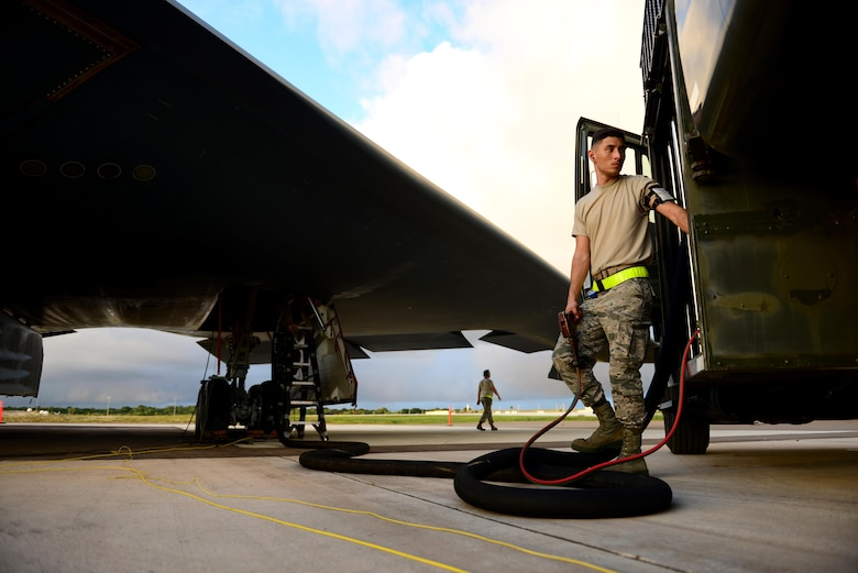 U.S. Air Force Airman 1st Class Armando Torres, a fuels distribution technician assigned to the 509th Logistics Readiness Squadron, monitors the control panel to ensure he maintains proper nozzle pressure and revolutions per minute while refueling a B-2 Spirit at Andersen Air Force Base, Guam, Jan. 17, 2017. The refueling operations are capable of delivering up to 600 gallons per minute. (U.S. Air Force photo by Airman 1st Class Jazmin Smith)